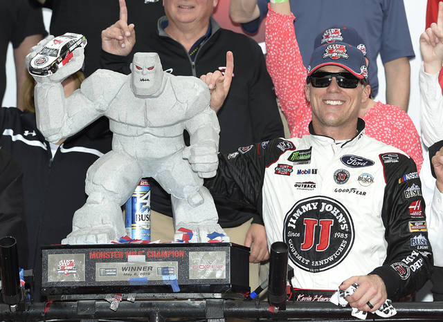 Kevin Harvick, right, poses with the trophy in Victory Lane after he won the NASCAR Cup Series auto race, Sunday, May 6, 2018, at Dover International Speedway in Dover, Del. (AP Photo/Nick Wass)