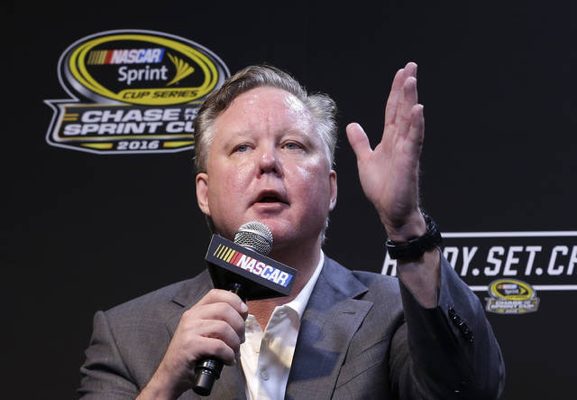 """FILE - In this Nov. 20, 2016, file photo, NASCAR CEO and Chairman, Brian France, talks to reporters during a news conference before a NASCAR Sprint Cup auto race practice in Homestead, Fla. NASCAR President Brent Dewar has told employees the France family """"remains dedicated to the long term growth of our sport."""" The memo was sent to employees on Tuesday, May 8, 2018, one day after a media report said the France family was exploring the sale of its stake in the nation's top auto racing series. (AP Photo/Alan Diaz, FIle)"""