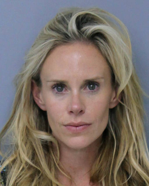 This Saturday, May 12, 2018 booking photo provided by St. Johns County, Florida, Sheriff's Office shows Krista Glover, the wife of former U.S. Open champion Lucas Glover.  She was arrested on charges related to domestic violence during the weekend of The Players Championship. (St. Johns County, Florida, Sheriff's Office via AP)