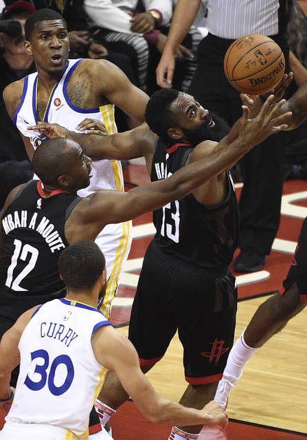 Houston Rockets guard James Harden, right, and forward Luc Mbah a Moute vie for a loose ball during the first half of Game 2 of the NBA basketball playoffs Western Conference finals against the Golden State Warriors, Wednesday, May 16, 2018, in Houston. (AP Photo/Eric Christian Smith)