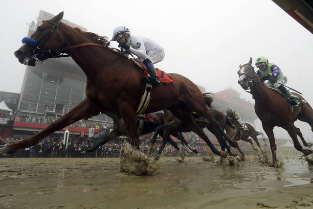 Justify with Mike Smith atop wins the the 143rd Preakness Stakes horse race at Pimlico race course, Saturday, May 19, 2018, in Baltimore. (AP Photo/Steve Helber)