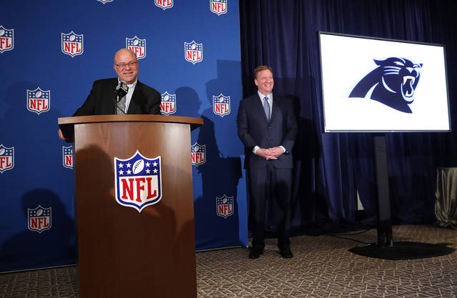 David Tepper, left, speaks as NFL commissioner Roger Goodall looks on during a news conference where he was introduced as the new owner of the Carolina Panthers at the NFL owners spring meeting Tuesday, May 22, 2018, in Atlanta. (AP Photo/John Bazemore)