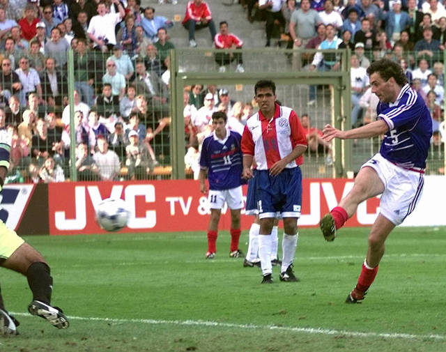 "FILE - In this Sunday, June 28, 1998 file photo, France's Laurent Blanc scores against Paraguay in extra time of a round of 16 soccer match at the World Cup at the Felix Bollaert stadium in Lens, France. Blanc's strike was the first ""golden goal"" in World Cup finals history to give France a 1-0 win over Paraguay. The 21st World Cup begins on Thursday, June 14, 2018, when host Russia takes on Saudi Arabia. (AP Photo/Luca Bruno, File)"