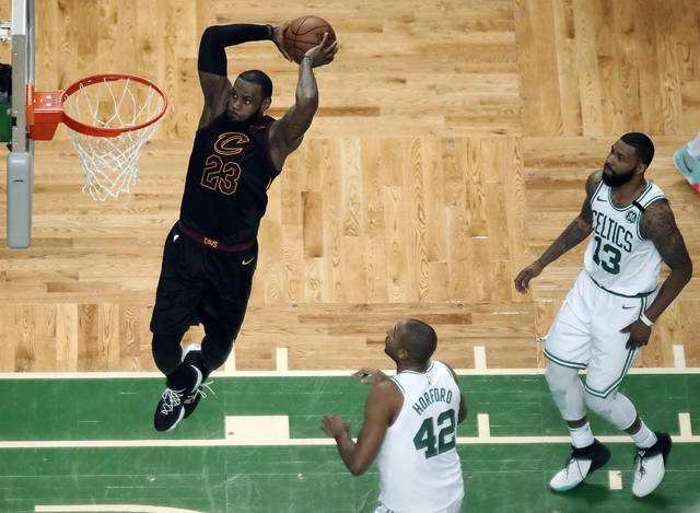 70d807243d0 Cleveland Cavaliers forward LeBron James soars to dunk in front of Boston  Celtics forward Al Horford (42) and forward Marcus Morris (13) during the  first ...