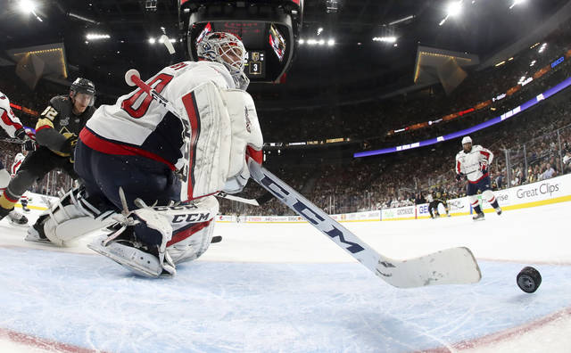 Washington Capitals goaltender Braden Holtby, right, stops a shot by Vegas Golden Knights left wing Tomas Nosek, of the Czech Republic, during the second period in Game 1 of the NHL hockey Stanley Cup Finals Monday, May 28, 2018, in Las Vegas. (Harry How/Pool via AP)