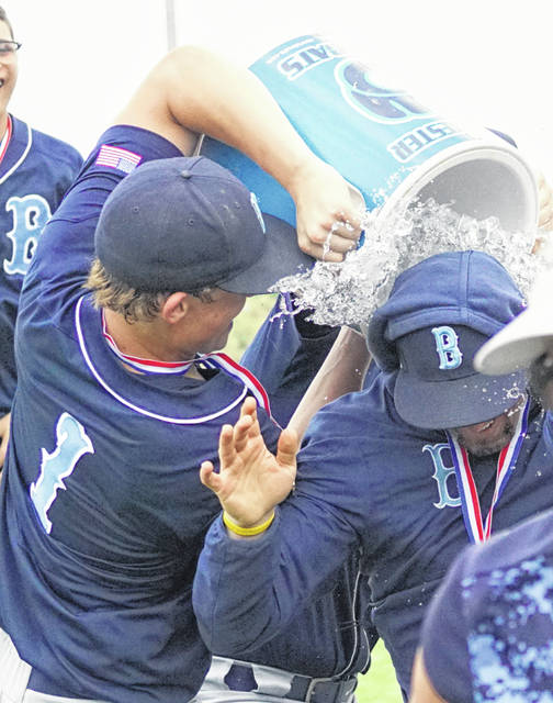 That moment right before you get drenched. Blanchester coach Aaron Lawson was given the obligatory ice water bath by Jack Davidson following Sunday's win over Carlisle.