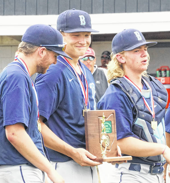 Blanchester's Brant Bandow (left), Jack Davidson (middle) and Cole Ficke (right) after the district championship trophy had been presented to the Wildcats baseball team Sunday at Waynesville High School.
