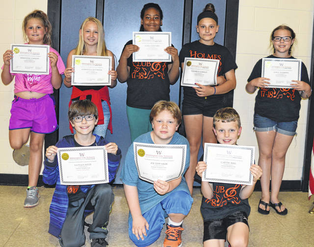Some members of the Holmes Singing Club are, kneeling from left, Nathan Ritze, Joe Edwards and Carter Bisig; and standing from left, Samantha Vaughn, Samantha Reynolds, Alexa Guevara, Elizabeth Gordley and Emily Andrews.