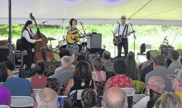 Carrie Rodriguez, center, with the other members of her trio, perform during the weekend Nowhere Else Festival in Martinsville.