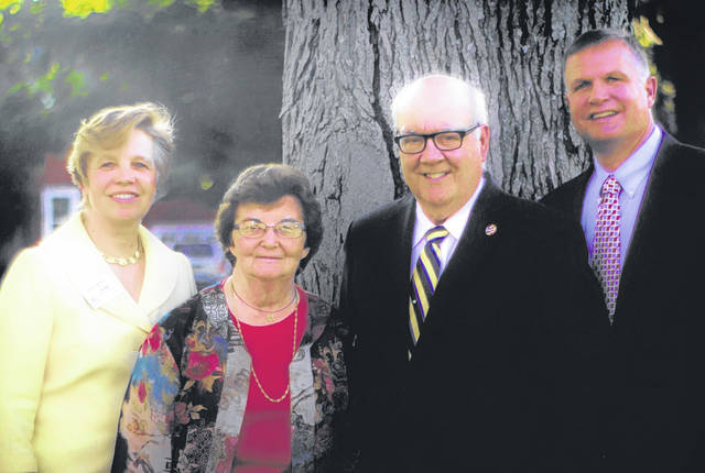 Two longtime leaders of Clinton County — Dr. Ruth Hayes and Patrick Haley (middle) — were honored for their professional and civic service Thursday evening during the 31st graduation ceremony of Leadership Clinton. Hayes and Haley are pictured with representatives of the Clinton County Leadership Institute, Diane Murphy, left, and Terry Habermehl, right.