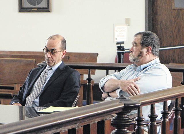 Timothy Manuel, right, sits in Highland County Common Pleas Court during a previous hearing with defense attorney Edward Perry, left.