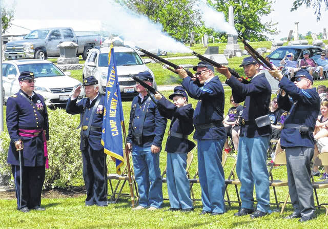 Members of Co. C, 20th Ohio Volunteer Infantry fires a musket salute.