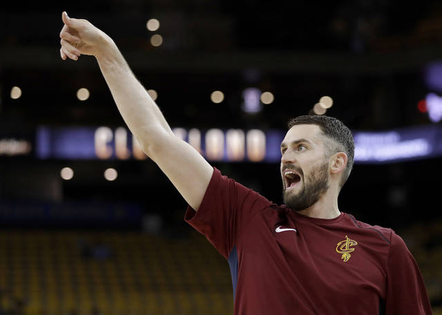 Cleveland Cavaliers forward Kevin Love warms up before Game 1 of basketball's NBA Finals between the Golden State Warriors and the Cavaliers in Oakland, Calif., Thursday, May 31, 2018. (AP Photo/Marcio Jose Sanchez)
