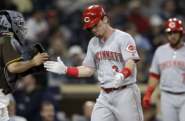 The Cincinnati Reds' Scooter Gennett reacts after hitting a home run during the fifth inning of a baseball game against the San Diego Padres Friday, June 1, 2018, in San Diego. (AP Photo/Gregory Bull)