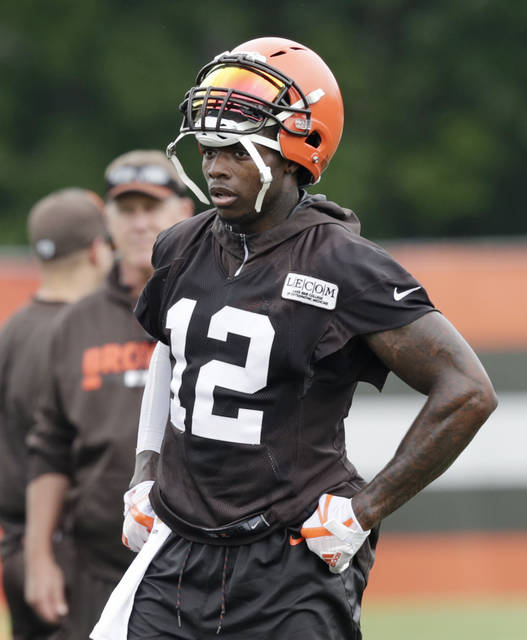 Cleveland Browns wide receiver Josh Gordon takes a break during practice at the NFL football team's training camp facility, Tuesday, June 12, 2018, in Berea, Ohio. Gordon's finding that this new route he's running through life, a straight and sober one, is rewarding him every day. (AP Photo/Tony Dejak)