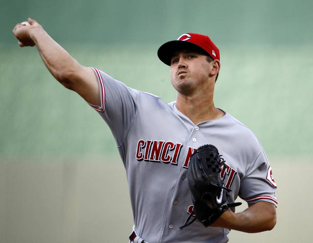 Cincinnati Reds starting pitcher Tyler Mahle throws during the first inning of the team's baseball game against the Kansas City Royals on Wednesday, June 13, 2018, in Kansas City, Mo. (AP Photo/Charlie Riedel)