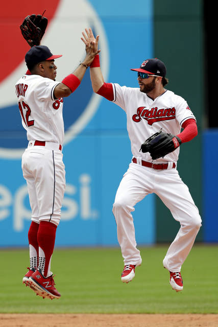 Cleveland Indians' Francisco Lindor, left, celebrates with Tyler Naquin after the Indians defeated the Chicago White Sox 12-0 in a baseball game, Wednesday, June 20, 2018, in Cleveland. (AP Photo/Tony Dejak)