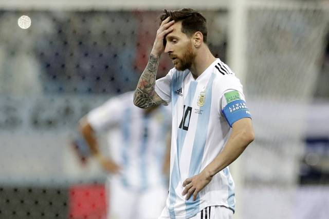 Argentina's Lionel Messi reacts after the third goal of Croatia during the group D match between Argentina and Croatia at the 2018 soccer World Cup in Nizhny Novgorod Stadium in Nizhny Novgorod, Russia, Thursday, June 21, 2018. Croatia won 3-0. (AP Photo/Petr David Josek)