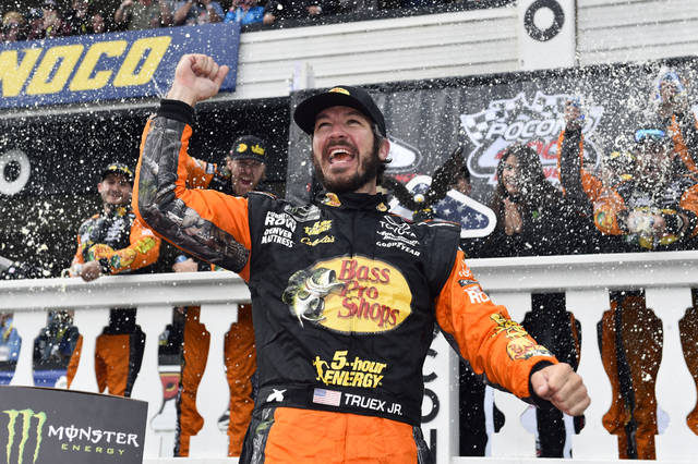 FILE - In this June 3, 2018, file photo, Martin Truex Jr. celebrates in Victory Lane after winning the NASCAR Cup Series auto race in Long Pond, Pa. Truex hopes to continue the good times this weekend at Sonoma Raceway as he tries to pull closer to Kyle Busch and Kevin Harvick in the points standings. Truex won at Sonoma in 2013. (AP Photo/Derik Hamilton, File)