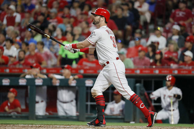 Cincinnati Reds' Jesse Winker watches his grand slam off Chicago Cubs relief pitcher Randy Rosario during the sixth inning of a baseball game Thursday, June 21, 2018, in Cincinnati. (AP Photo/John Minchillo)