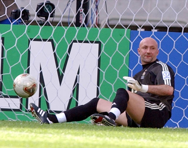 FILE - In this Tuesday, June 11, 2002 file photo, France's goalkeeper Fabien Barthez sits on the ground with the ball in the net after Denmark scored their second goal to win 2-0 and knock France out of the tournament at the group stage in the Incheon Munhak Stadium in Incheon, South Korea. On Wednesday, June 27, 2018, Germany became the latest world champion to be eliminated from the World Cup at the group stage. (AP Photo/Vincent Yu, File)