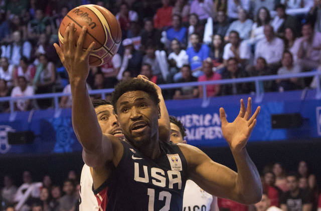 U.S. player Kevin Jones competes for the ball with Mexico's  Gustavo Ayon during the first quarter of a regular season FIBA basketball World Cup qualifier in Mexico City, Thursday, June 28, 2018. (AP Photo/Christian Palma)