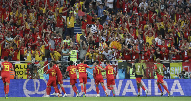 Belgium players celebrate scoring their side's first goal during the group G match between England and Belgium at the 2018 soccer World Cup in the Kaliningrad Stadium in Kaliningrad, Russia, Thursday, June 28, 2018. (AP Photo/Petr David Josek)