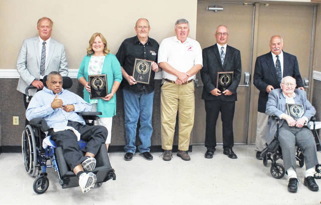 The 2018 class of the Clinton County Sports Hall of Fame was inducted Thursday night at the Expo Center on the Clinton County Fairground. Those inducted were Susan Burnett Holliday, Bruce McKee, Brian Mudd, Jim Rankin and Daniel E. Watson. In the photo are the inductees along with their presenters, from left to right, McKee, Gary Downing, Holliday, Rankin, Dick Miller, Watson and John Watson. Travis Miller was a presented but not present for the photo.