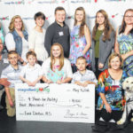 EC students donate $4K to 4 Paws for Ability to help local family