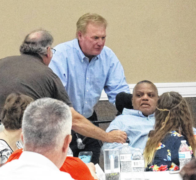 Bruce McKee, lower right, and former teammate Gary Losey, standing, at the 2018 Clinton County Sports Hall of Fame Induction Ceremony at the Expo Center on the Clinton County Fairgrounds.