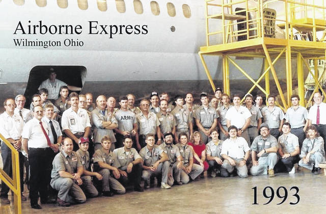 This group photo, which includes Darrin Tissandier, shows workers at Airborne Express in Wilmington in 1993. Tissandier is standing, just to the right of the middle, hat on and hands crossed.
