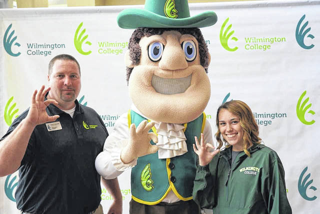 "Meeting the mascot, Quakerman, was a highlight of Wilmington College's Summer Orientation Wednesday for Caitlin Miner, a Wilmington resident and graduate of Clinton-Massie High School, who also is pictured flashing the ""WC sign"" with her admission representative, Steve Cukovecki. She, along with other new students and their parents, spent the day learning about everything from academic policies, procedures and support services to the student code of conduct and the financial aid/billing process. Also, specially focused sessions were held for prospective student-athletes, commuter students and those planning to reside on campus. The day's orientation activities are designed to help students and parents navigate the college experience and for new students to hit the ground running when they arrive in August. Future Summer Orientation days for the rest of the entering class will be held in mid-July and early August."