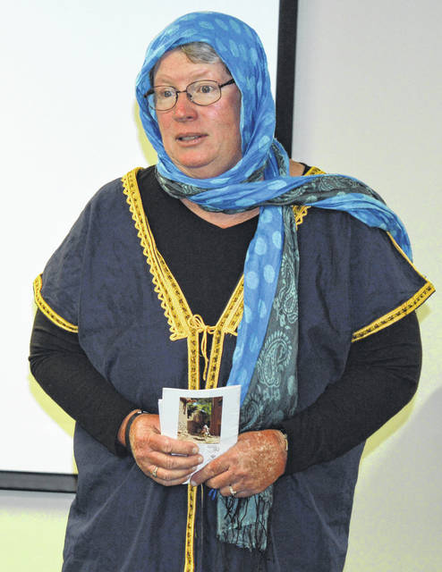 Sharon Frost of Wilmington spoke Tuesday evening at the Wilmington Public Library regarding her recent 19 days in Iran on a peace fellowship trip. She wore Iranian garb for her talk, including the traditional women's scarf called the hijab. About 15 people attended the event, and saw a slide show featuring many beautiful mosques and the people of Iran, who treated her well, she said. She saw multiple statues of poets, and on at least one occasion a shopkeeper sang. Frost has visited 132 countries altogether.