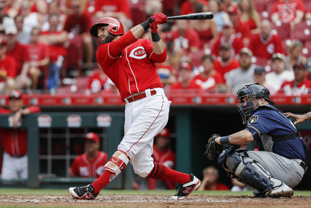 Cincinnati Reds' Jose Peraza hits a grand slam off Milwaukee Brewers relief pitcher Aaron Wilkerson in the sixth inning of a baseball game, Sunday, July 1, 2018, in Cincinnati. (AP Photo/John Minchillo)