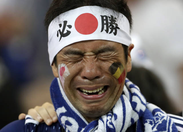 A Japan supporters cries after losing the round of 16 match between Belgium and Japan at the 2018 soccer World Cup in the Rostov Arena, in Rostov-on-Don, Russia, Monday, July 2, 2018. (AP Photo/Petr David Josek)