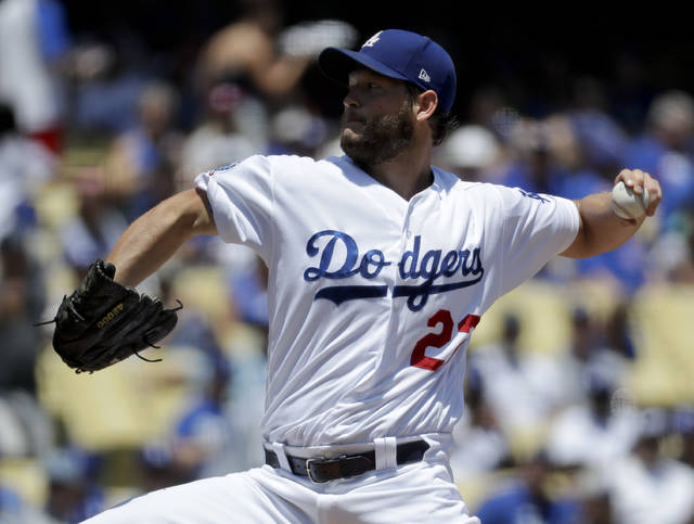 Los Angeles Dodgers starting pitcher Clayton Kershaw throws against the Chicago Cubs during the first inning of a baseball game in Los Angeles, Thursday, June 28, 2018. (AP Photo/Chris Carlson)