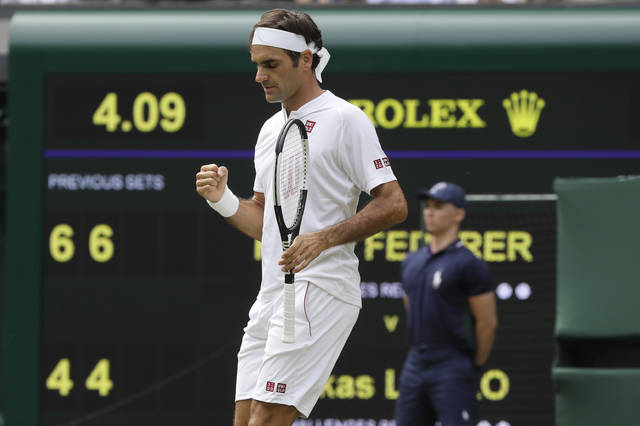 Switzerland's Roger Federer celebrates his match point against Slovakia's Lukas Lacko in their men's singles match, on the third day of the Wimbledon Tennis Championships in London, Wednesday July 4, 2018. (AP Photo/Kirsty Wigglesworth)