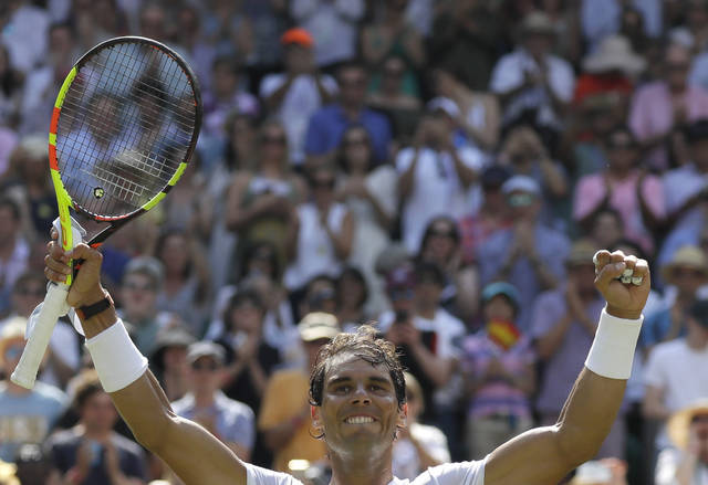 Rafael Nadal of Spain celebrates winning his men's singles match against Australia's Alex de Minaur, on the sixth day of the Wimbledon Tennis Championships in London, Saturday, July 7, 2018. (AP Photo/Kirsty Wigglesworth)