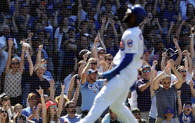Chicago Cubs' fans celebrate after Jason Heyward scored on a two-run single by Javier Baez during the seventh inning of a baseball game against the Cincinnati Reds, Sunday, July 8, 2018, in Chicago. (AP Photo/Nam Y. Huh)