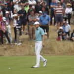 The Latest: Koepka goes 41-31 for wild 72 at British Open