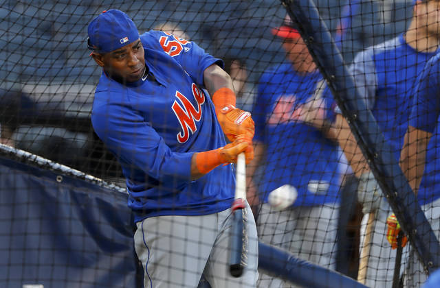 New York Mets' Yoenis Cespedes takes batting practice before a baseball game against the New York Yankees, Friday, July 20, 2018, in New York. (AP Photo/Julie Jacobson)