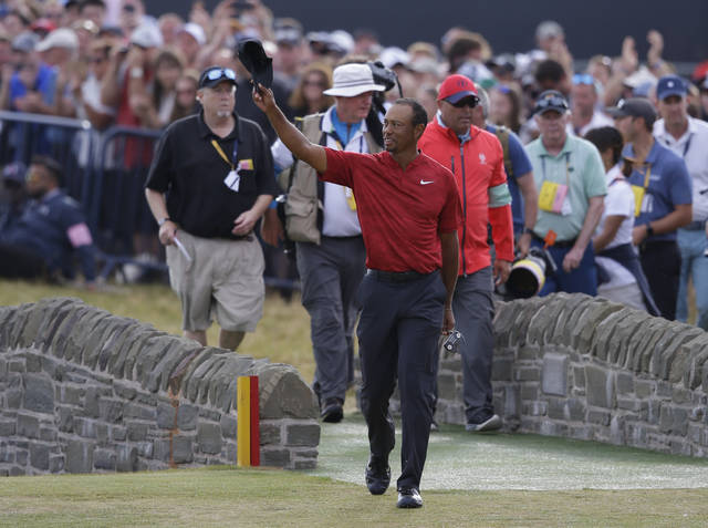 Tiger Woods of the US walks onto the 18th green during the final round for the 147th British Open Golf championships in Carnoustie, Scotland, Sunday, July 22, 2018. (AP Photo/Martin Cleaver)