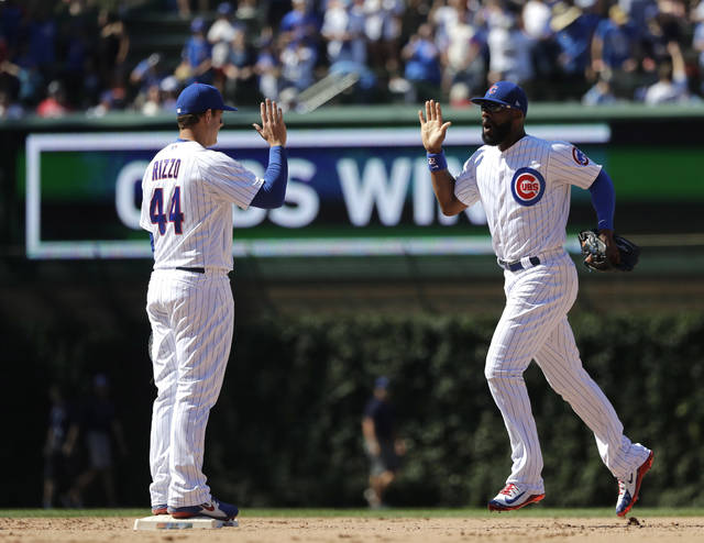 Chicago Cubs' Anthony Rizzo, left, and Jason Heyward celebrates the team's 2-1 win over the Arizona Diamondbacks after a baseball game Wednesday, July 25, 2018, in Chicago. (AP Photo/Charles Rex Arbogast)