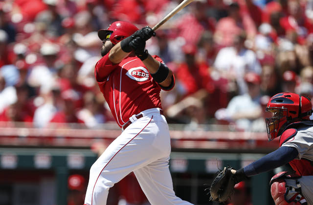 Cincinnati Reds' Eugenio Suarez hits a two-run home run off St. Louis Cardinals starting pitcher Jack Flaherty during the first inning of a baseball game, Wednesday, July 25, 2018, in Cincinnati. (AP Photo/Gary Landers)