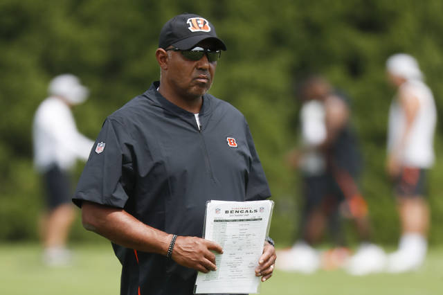 Cincinnati Bengals head coach Marvin Lewis works the field during NFL football practice, Thursday, July 26, 2018, in Cincinnati. (AP Photo/John Minchillo)