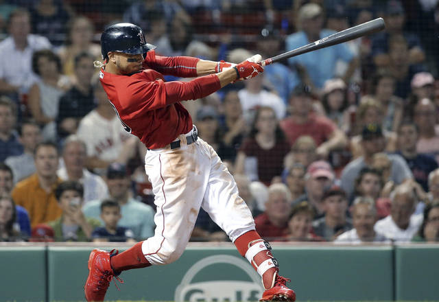 Boston Red Sox's Mookie Betts hits a walk-off solo home run in the 10th inning of the team's baseball game against the Minnesota Twins at Fenway Park, Friday, July 27, 2018, in Boston. The Red Sox won 4-3. (AP Photo/Elise Amendola)