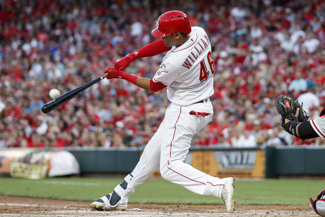 Cincinnati Reds' Mason Williams hits a three-run home run off Philadelphia Phillies starting pitcher Nick Pivetta in the fourth inning of a baseball game, Friday, July 27, 2018, in Cincinnati. (AP Photo/John Minchillo)
