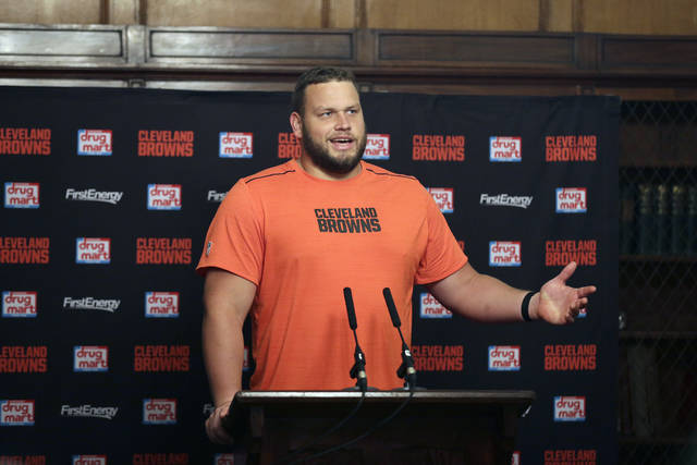 FILE - In this Oct. 27, 2017, file photo, Cleveland Browns offensive lineman Joel Bitonio speaks during a press conference following a training session in Bagshot, England. Bitonio would rather not be the one to try and fill Joe Thomas' legendary shoes. One of the NFL's top left guards, Bitonio is content staying at that position unless the Browns need him to slide over and replace Thomas, the 10-time Pro Bowl tackle who retired after last season, leaving a massive hole in Cleveland's line and locker room. (AP Photo/Tim Ireland, File)