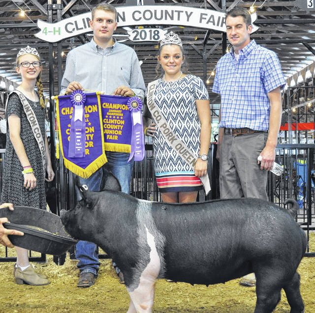 In Overall Champion Purebred, shown are Pork Princess Mikala Hatfield, winner Jay Schneider, Pork Queen Jenna Victor and Judge David Korb.