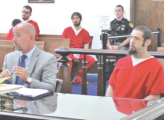 Ian Cluxton, right, sits in Highland County Common Pleas Court on Thursday with attorney J.D. Wagoner.
